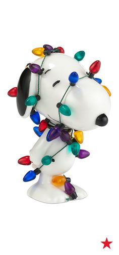 We're just nuts for this holiday figurine. Snoopy got a little carried away with the decorating... and so will you!