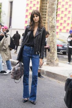Winter outfit ideas that include deinm: flare jeans and a leather motorcycle jacket