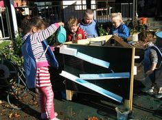 let the children play: planning a new water wall for water play. let the children build there own toys that they want to play with.