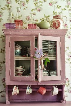 floral wall and pink vintage cabinet