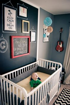 Gray Nursery with Chalkboard Wall - love the funky gallery wall over the crib!