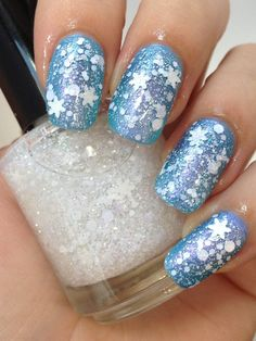 First Snow by Noodles Nail Polish ($8.75)  I looove this!  It looks just like fresh fallen snow!  The blue underneath is a perfect pairing; but I'd love to experiment with a silvery-grey, a christmas tree green, or even a light pink.  I'm buying this one NOW!  :)