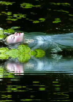 Under tower and balcony, By garden wall and gallery, A pale, pale corpse she floated by, Deadcold, between the houses high,        Dead into tower'd Camelot. Knight and burgher, lord and dame, To the planked wharfage came: Below the stern they read her name,        The Lady of Shalott