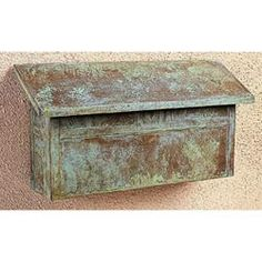 Antiqued wall mounted mailbox.