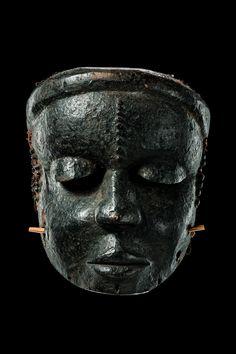 "Mask ""idiok ekpo"" Nigeria, Ibibio - wood, black encrusted patina, burled scarification marks, plant fibre bonnet, crossbar for fixing the mask with the teeth."