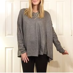 • Gray Sweater • Features: heather gray plain sweater with a slight vneck. True to size I am wearing a small/medium. This sweater does run wide though.  Available in S/M and M/L  NO TRADES PRICE FIRM 15% BUNDLES Sweaters