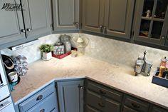 Helix Silestone Countertops; Arabesque Marble Backsplash