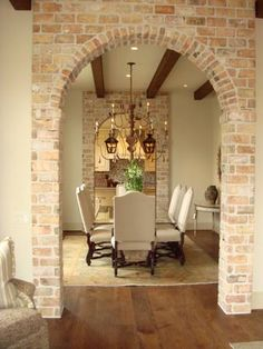 Cream walls, exposed brick, dark beams.Can take out wall between foyer and column one day and do this