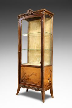 «Clématites», a moulded and carved mahogany cabinet decorated with an exotic wood marquetry.Signed on the lower right «L.Majorelle».Circa1900.