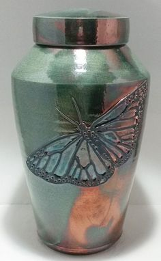 The unique Butterfly Raku Urn is a hand-thrown ceramic cremation urn made with love by a ceramic artist with over 30 years of experience in her craft. The urn is decorated with a raised carved butterfly. Cremation Urns, Cremation Jewelry, Funeral Planning, Funeral Ideas, When Someone Dies, Funeral Urns, Memorial Urns, Ceramic Artists, Carving