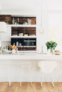"""A Gorgeous, Sun-Filled Denver Home Tour. Pulling inspiration from the land surrounding this amazing modern, bohemian loft in the heart of Denver, Colorado,""""They wanted to incorporate their deep love of nature, so we worked to bring the outdoors inside,"""" Layne explained. """"Plants, cactus, crystals, stones and scent was really soothing for the couple, so we wanted to create and cultivate a sensory experience that kept their home feeling like a safe, nurturing space."""""""