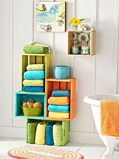 Inexpensive wood crates painted in bright colors bring fresh style to a bathroom. Multiply the number of crates to create affordable and unique bookshelves in an office or as media storage in a living room.