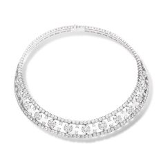 this delicate bridal jewellery set highlights the whole look. (otherwise it'll be too plain with the simple/countryside gown/hair/shoes)... from Van Cleef& Arpels, my all time favorite.