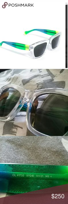 Sold out! Authentic ombré clear Celine sunglasses Retail for $500 sold out everywhere. Worn a few times. Small scuffs not noticeable when wearing. Photos shown of lenses. Make me an offer I can't refuse. Blue green clear ombré with a slight shimmer. Such beautiful glasses, don't fit my face or I'd keep. Comes with case Celine Accessories Sunglasses