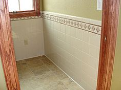 half wall tile- general idea, don't like how different the tile on the floor and walls are