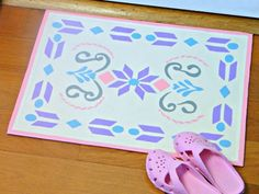 """This painted Frozen castle-inspired floor mat is the perfect project for moms and daughters who routinely belt """"Let it goooo!"""" together on the drive home from school. Get the tutorial at Mark Montano »   - Redbook.com"""