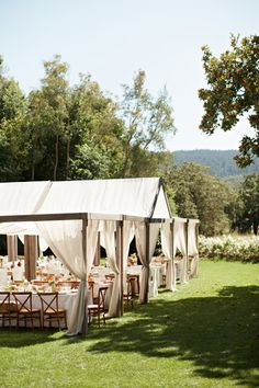 Annadel Estate Vineyard Wedding: Outdoor setup, tables, draping, tent.