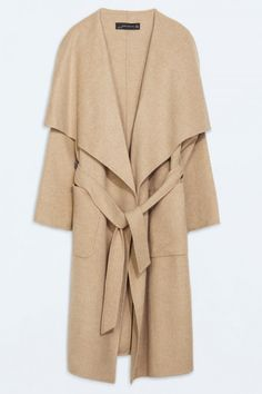 Throw this long Zara coat over anything for a classically elegant winter look.