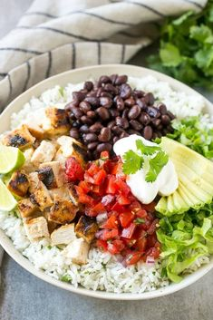 19 Quick And Easy Meals You'll Actually Want To Make Over And Over Again Chicken Burrito Bowl, Chicken Burritos, Burrito Bowls, Chicken Spices, Butter Chicken, Chicken Curry, What Is A Burrito, Marinated Grilled Chicken, Cilantro Lime Rice