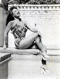 Carmen Miranda looking all kinds of glam and gorgeous (complete with stellar heels, natch!) on a diving board. #vintage #1940s #actresses #summer #swimsuits  I have a pair of shoes with heels like this and have never had the right dress to wear them with!