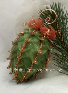 So pretty. Could be used at christmas or Thanksgiving. Quilted Ornament Pinecone Sparkling Copper by MyPrairieCreations~etsy