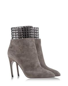 Sergio Rossi Soft suede booties in neutral hues and an architectural twist that offer endless styling possibilities.