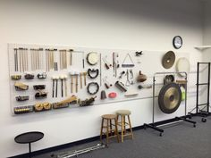 Pegboard as storage solution for auxiliary percussion equipment. Pegboard as storage solution for auxiliary percussion equipment.