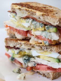 Cobb Grilled Cheese...gouda, chicken breast, tomato, avocado, hard boiled egg, bacon, blue ch...