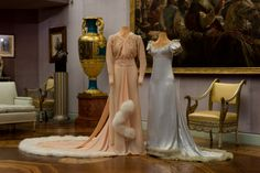 Wedding Dress and Bridesmaid Dress, 1935 Worn by Marjorie Merriweather Post and bridesmaid dress worn by Dina Merrill for Post's 1935 wedding to Joseph E. Davies, photographed in the pavilion at Hillwood. Photo by Ed Owen