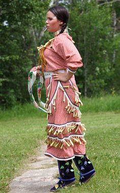 The beauty and Grace of a Native princess in a jingle dress dancing for the Creator