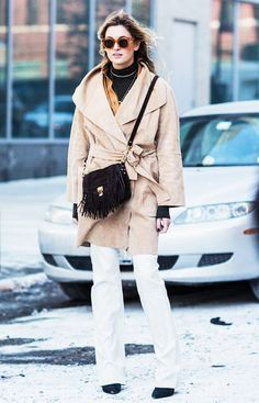 Camille Charrière of Camille Over the Rainbow in a camel wrap coat and fringe PS1 bag // NYFW Street Style