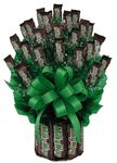 Send a Milky Way Candy Bouquet to a friend or employee as a recognition gift, a birthday present or a gift for any occasion.  We guarantee that they will just love this mouth watering chocolate gift of nothing but Milky Way Bars!  Send it to college student as a college care package today!This Large size Milkyway Candy Bouquet contains: 23 fun size candy bars and 11 full size candy bars to make up the base. Our bouquet is wrapped in a cellophane bag and topped with a bow.Medium Size:  7…
