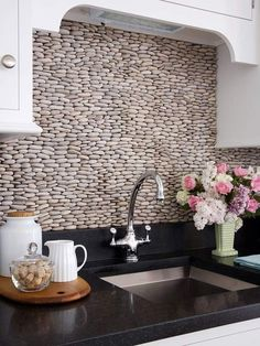 ungrouted stacked pebble backsplash- I hate grout.  But would have to be sealed... maybe in the laundry room?