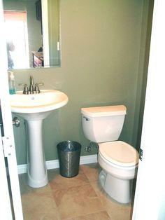 Pedestal Sink, Travertine Tile Floors