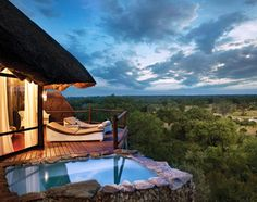 Leopard Hills is a stunning retreat built on a hill with superb views overlooking Sabi Sand game reserve in South Africa. The luxury lodge consists of eight luxurious glass-fronted suites, complete with their own sun deck and rock plunge pool with br Places To Travel, Travel Destinations, Places To Go, Dream Vacations, Vacation Spots, Beach Paradise, Sand Game, Kruger National Park, Game Reserve