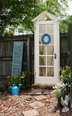 DIY Small Garden Shed. Love this! Made from old doors & windows!