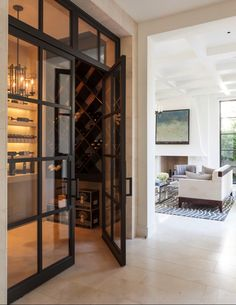 Consider salvaged steel windows as wine room enclosure