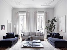 living em tons neutros e teto com textura clássica
