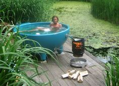 Fire heated outdoor tub. Would love a teak version of this!!! Dislike hot tubs that bubble but would love an outdoor soaking tub!!