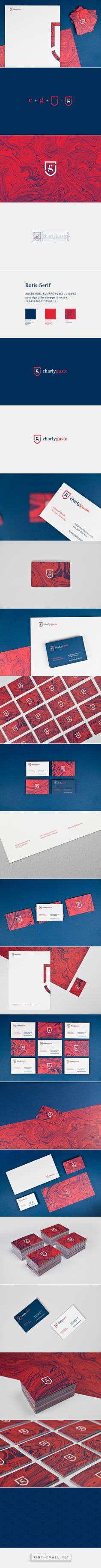 "Charly Gusto has used a crest with fusion of lowercase serif ""g"" and ""c"" as a logo. He has followed a colour scheme of red white and blue as a brand identity. The logo has been applied on business cards, web and the side of the crest has been used for a letter. The simple design makes it recognisable across the mediums, which is why I think cutting off most of the logo works on the letter paper."