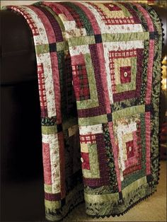 Quilt idea: Christmas log cabin quilt with buttons in center squares.