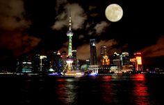 A full moon over Lujiazui skyline. Shanghai, China.