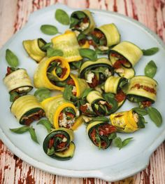 Involtini Di Zucchini (aka Roasted Courgette Rolls) recipe by Carluccio and Contaldo  Ideal to serve at get togethers with a glass of Prosecco. It's a modern antipasto, combining a typically southern Italian vegetable with a classic northern cheese. From Achica Living at http://www.achicaliving.com/2012/04/carlucciorecipe/