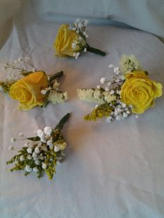 Yellow rose button holes