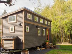 Gorgeous Tiny House Boasts 14 Windows and Nifty Storage Stairs - Curbed