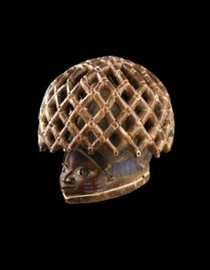 Africa | 'Gelede' helmet mask from the Yoruba people of Nigeria / Benin | Wood, pigment | ca. end of the 19th to early 20th century
