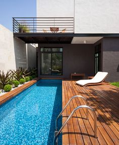 Mexican House in Neutral Color Palette with Lots of Warm Wood mexican house pool area
