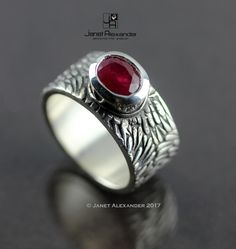 Fine silver ladies ring with natural Ruby oval stone. Stone measures 8mm x 6mm. The ring is a size 7.