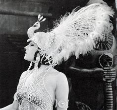 """1920s movie star Gloria Swanson wearing a wonderful pearl and feather peacock headdress and costume from the movie """"Male and Female"""", 1919."""