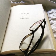 You know you're enjoying a book when glasses from the night before are your bookmark.